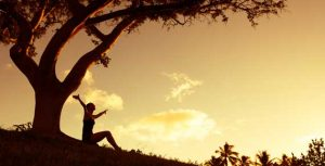 Happy woman under a tree